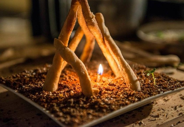 The little camfire made of truffle butter and rybread sticks and an almond pit burning.